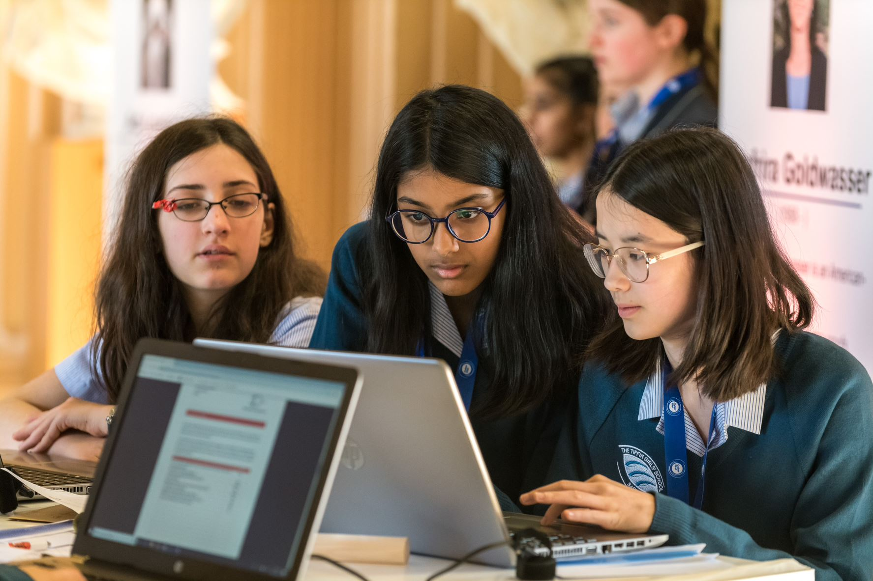 Young girls compting at the 2019 CyberFirst Girls Competition.